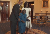 Virginia McLaurin with Barack and Michelle Obama