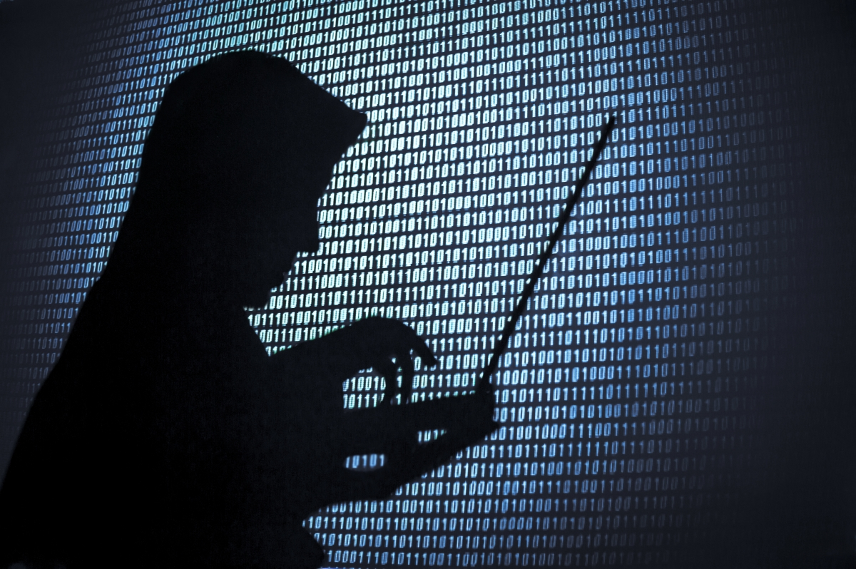 A mysterious hacker on a laptop