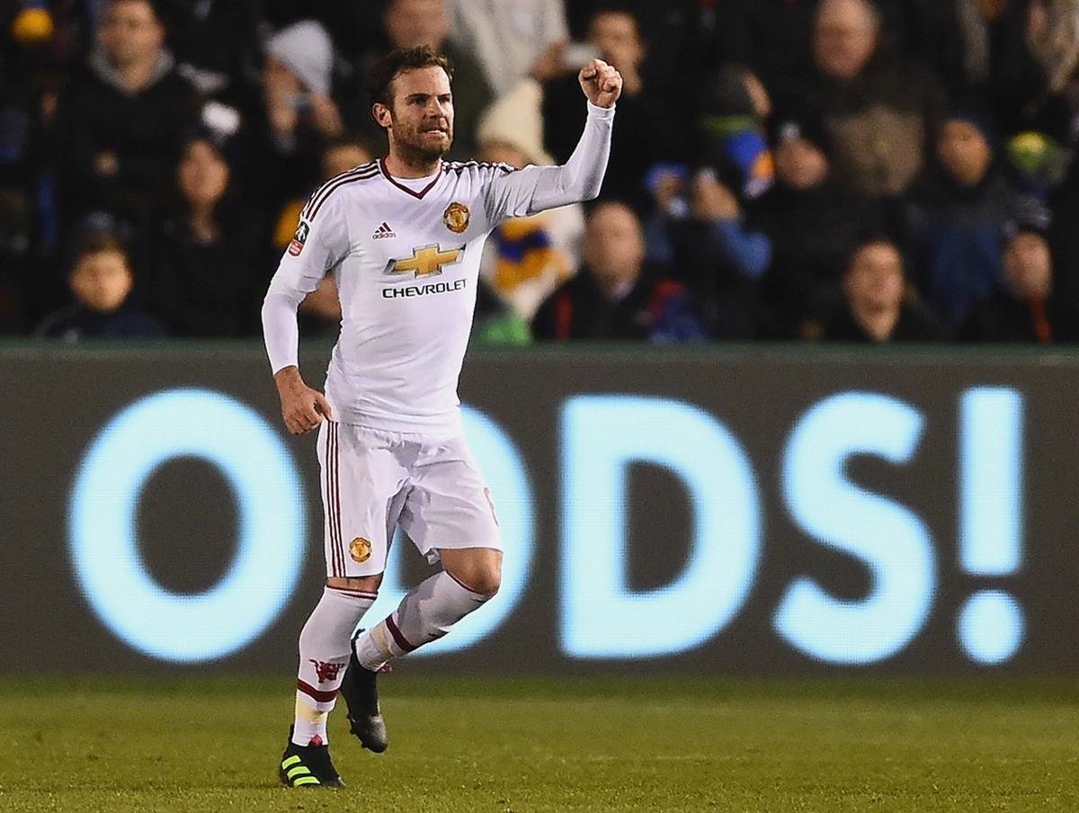 Juan Mata celebrates his goal
