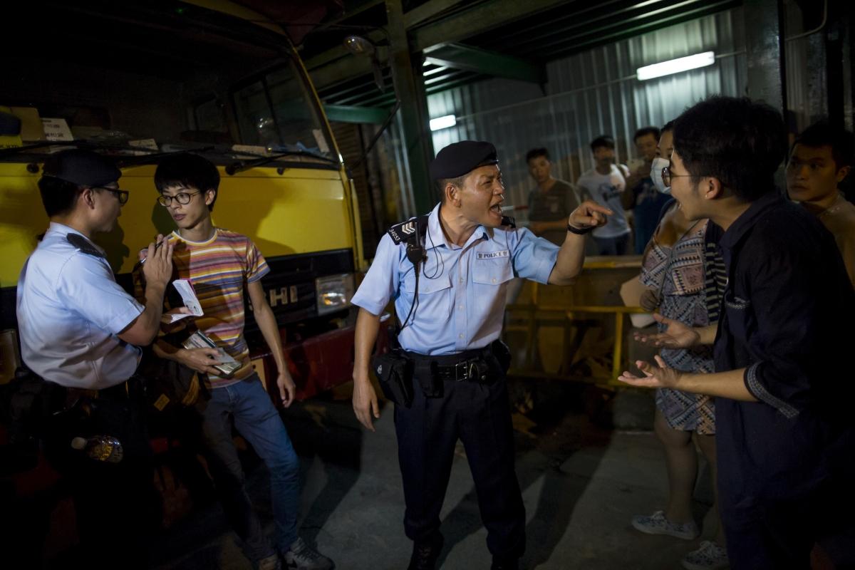 Activists Ray Wong
