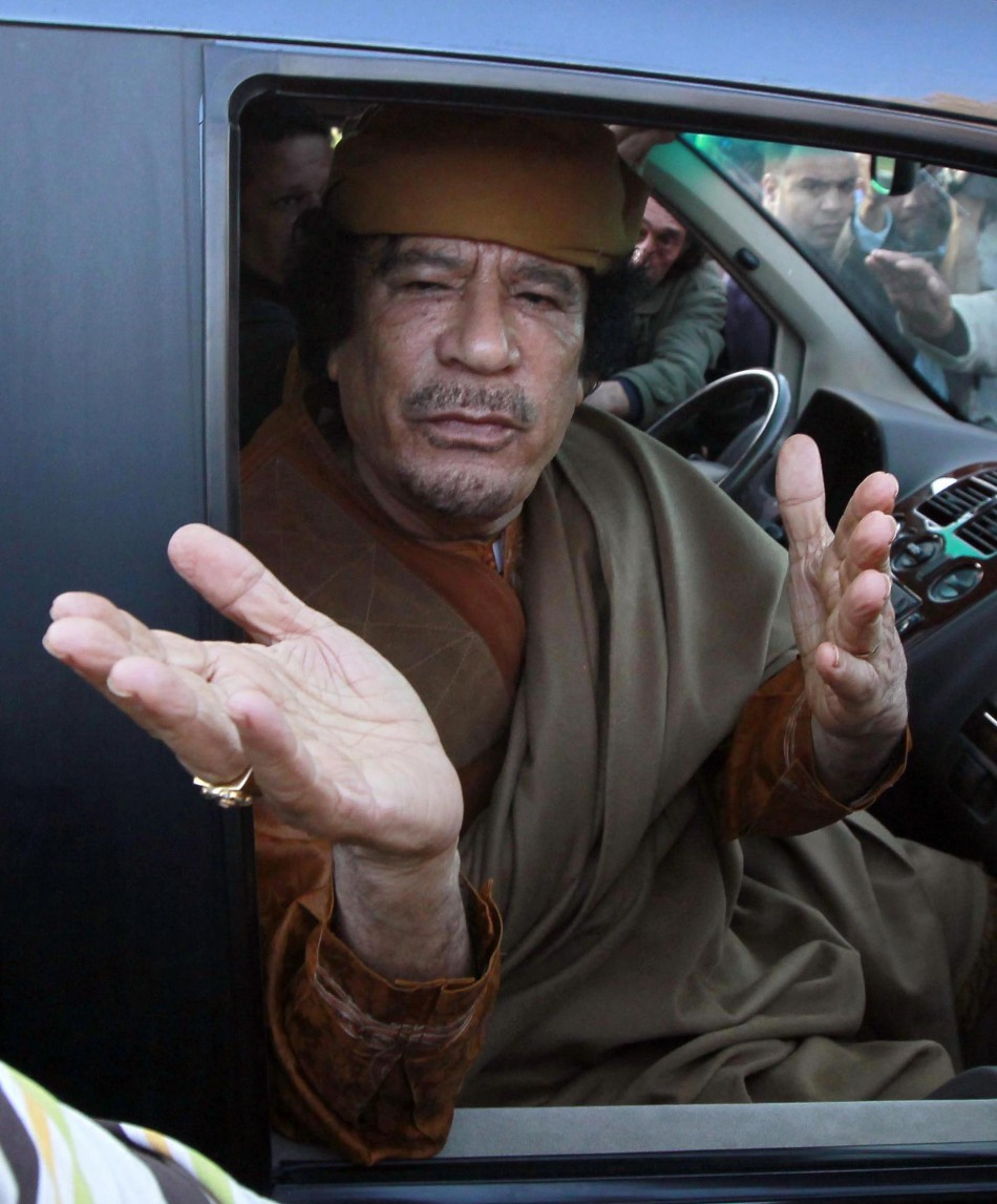 File photograph of Libyan leader Moammar Gadhafi gesturing from a car in the compound of Bab Al Azizia in Tripoli