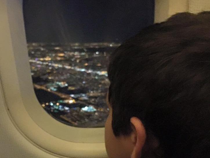 Passengers clap as boy leaves flight