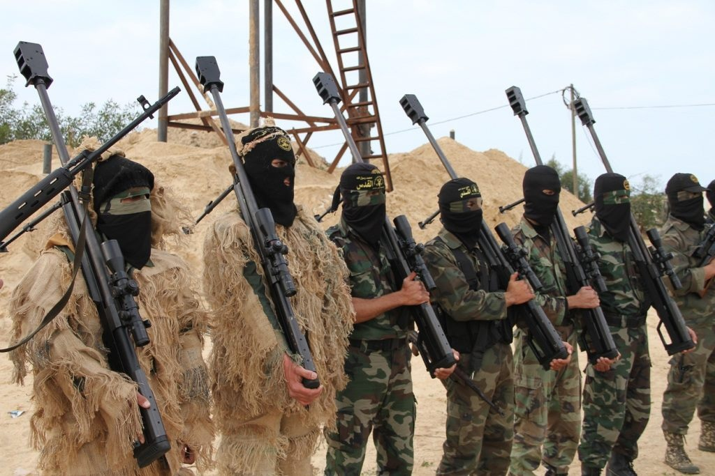 Men holding weapons in the Middle East