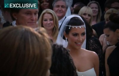 Bruce Jenner, Kardashians step father,  is walking Kim down the aisle.