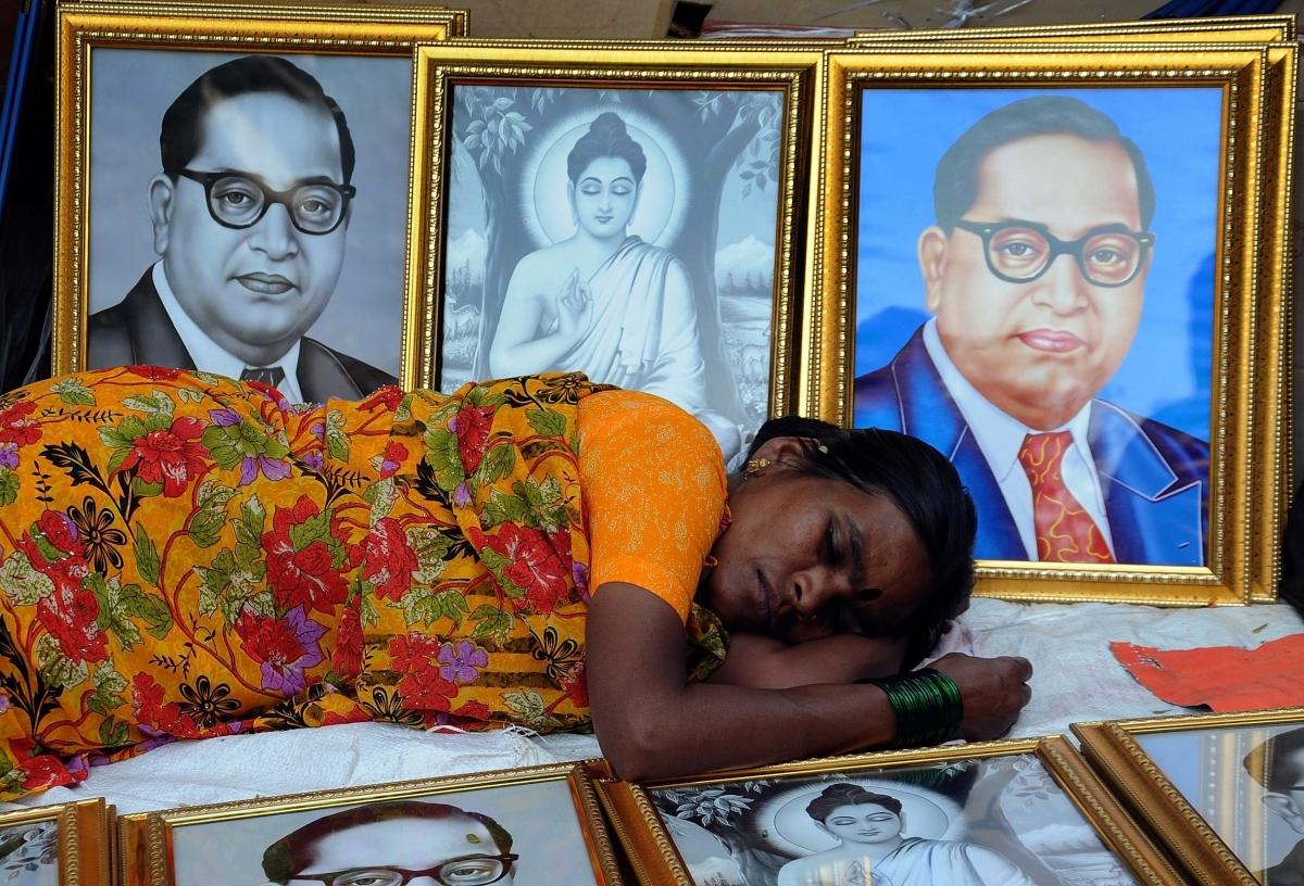 Woman sleeps among Ambedkar picture