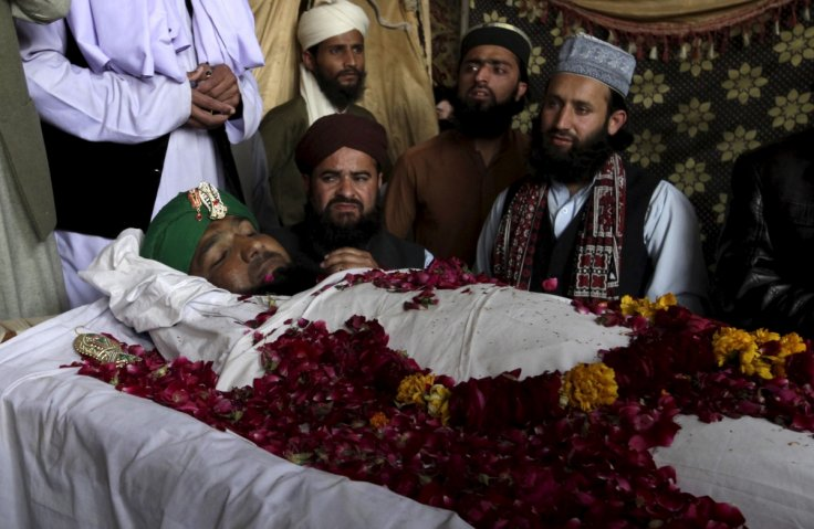 Supporters and family members of Mumtaz Qadri