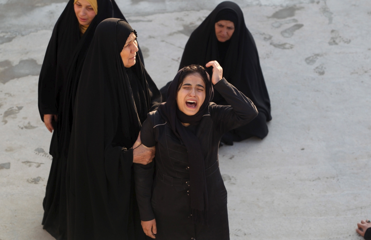 A woman reacts during a funeral