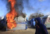 Calais jungle in flames