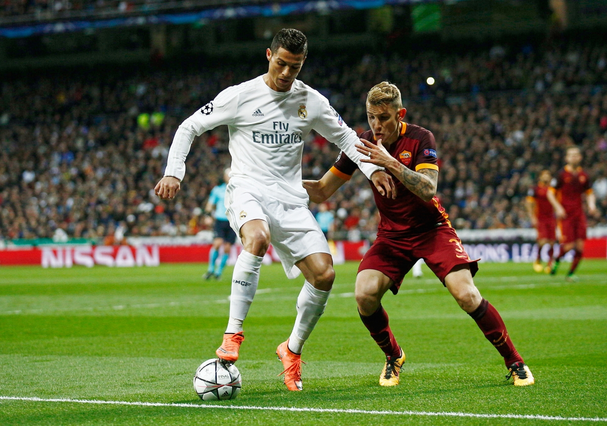 Ronaldo protects the ball from a defender