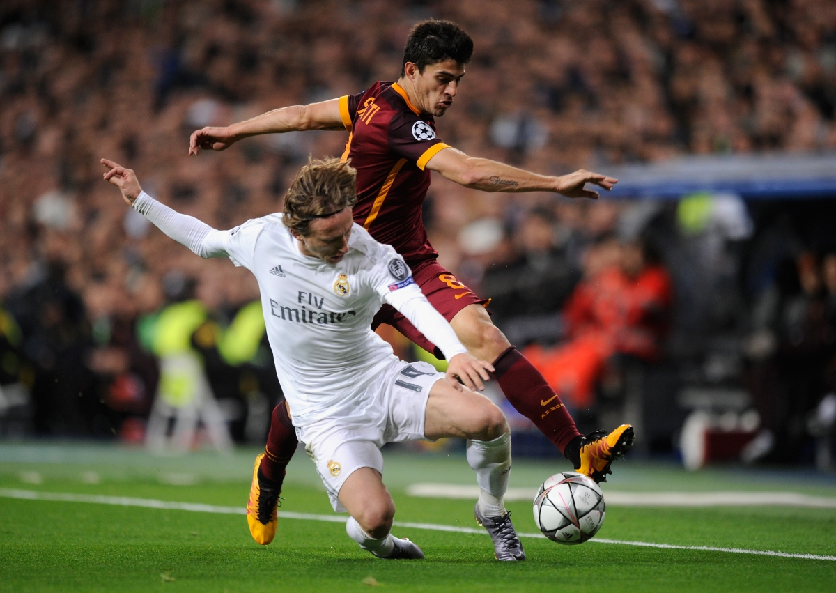 Modric fights for the ball