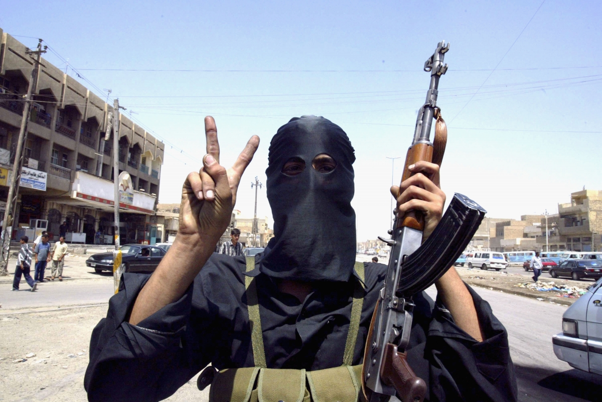An Iraq militant shows the 'V forvictor