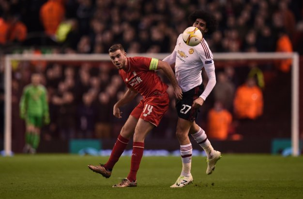 Jordan Henderson fights to win the ball