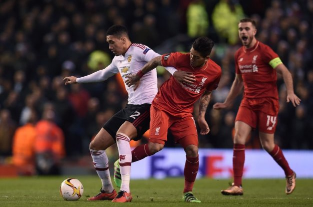 Chris Smalling scraps for the ball