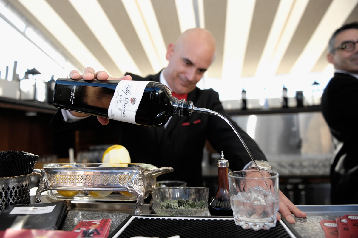 A bartender pours gin