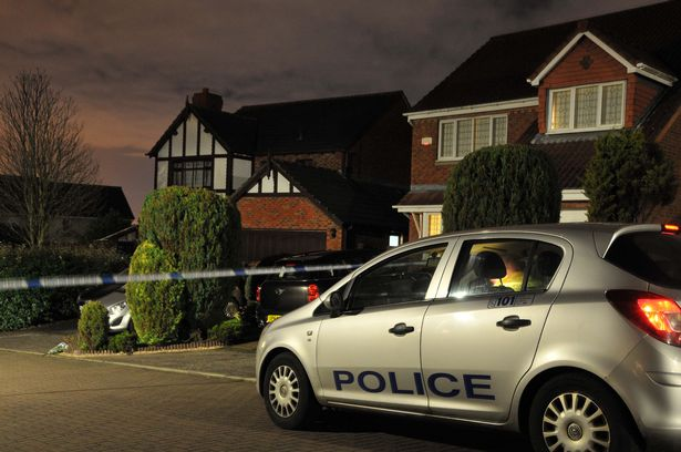 Police outside the twins' home in Dalgety Bay, Fife