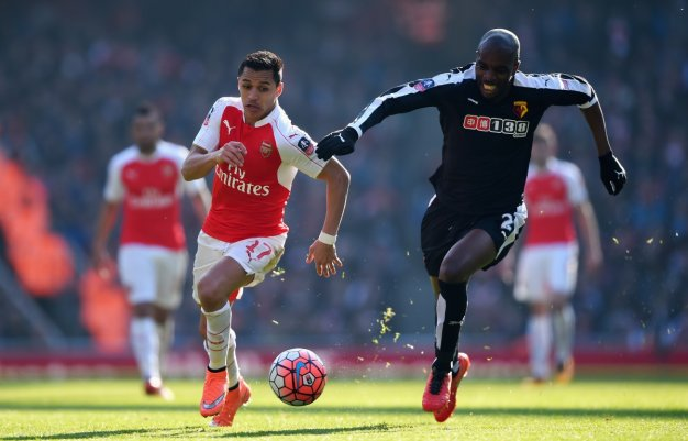 Alexis Sanchez (left) chases the ball