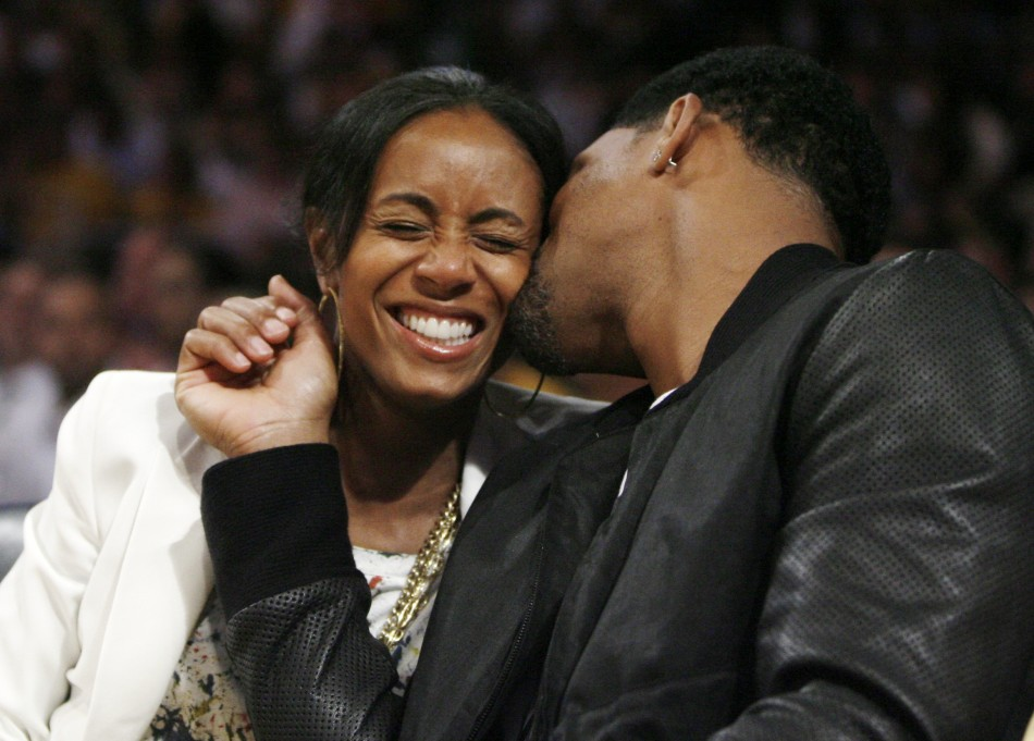 Actor Will Smith kisses his wife Jada Pinkett-Smith