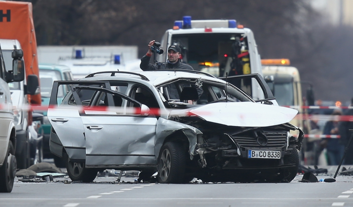 Investigators at the scene of today's carbombexplosioninBerlin