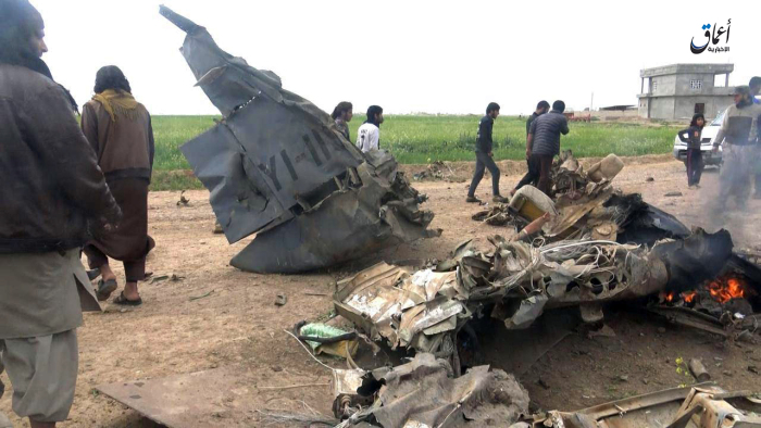 Fighters combing through the wreckage