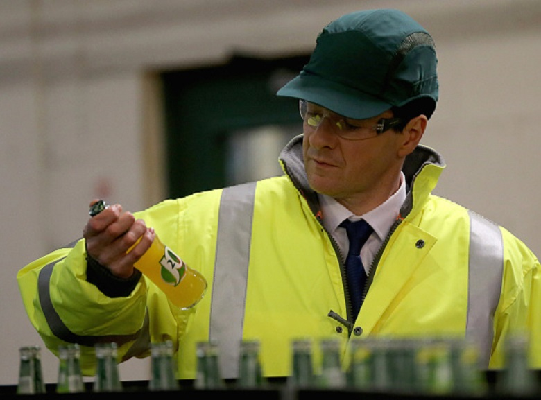 George Osborne holds a soft drink