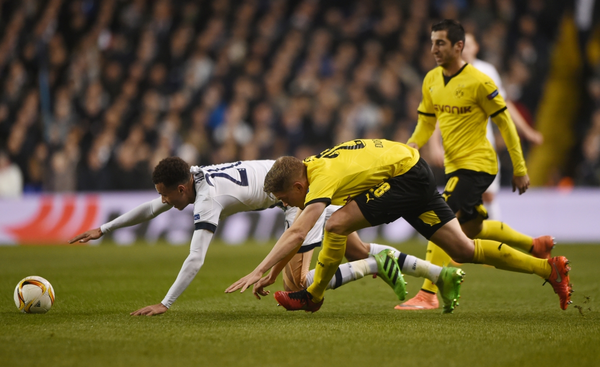 Dele Alli falls to the ground