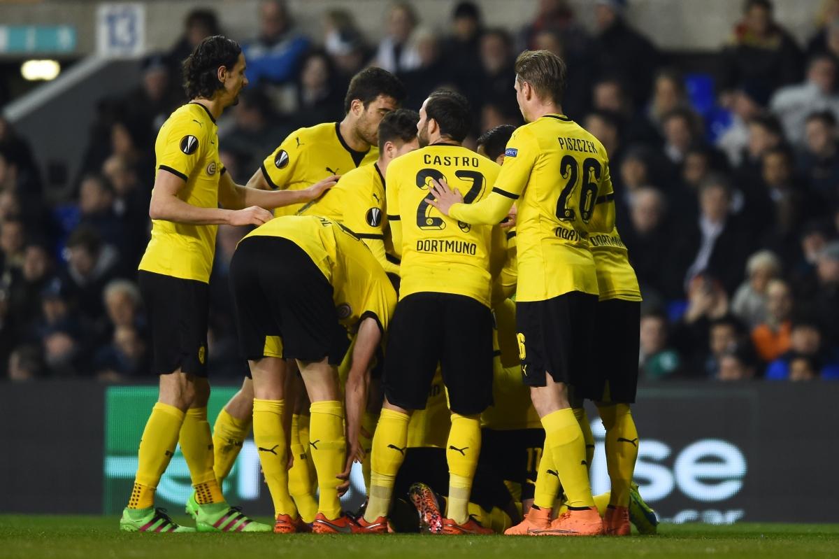 Dortmund players celebrate at the Lane