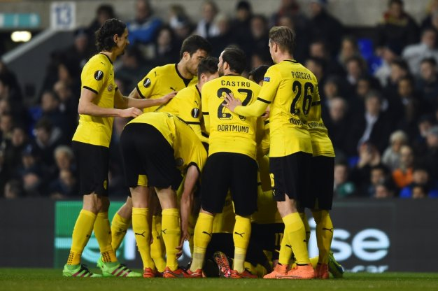 Dortmund players celebrate at the Lane