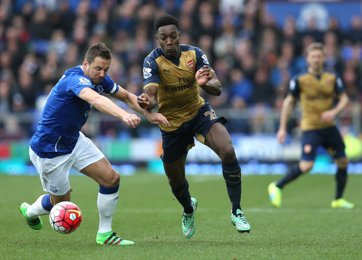 Danny Welbeck scraps for the ball