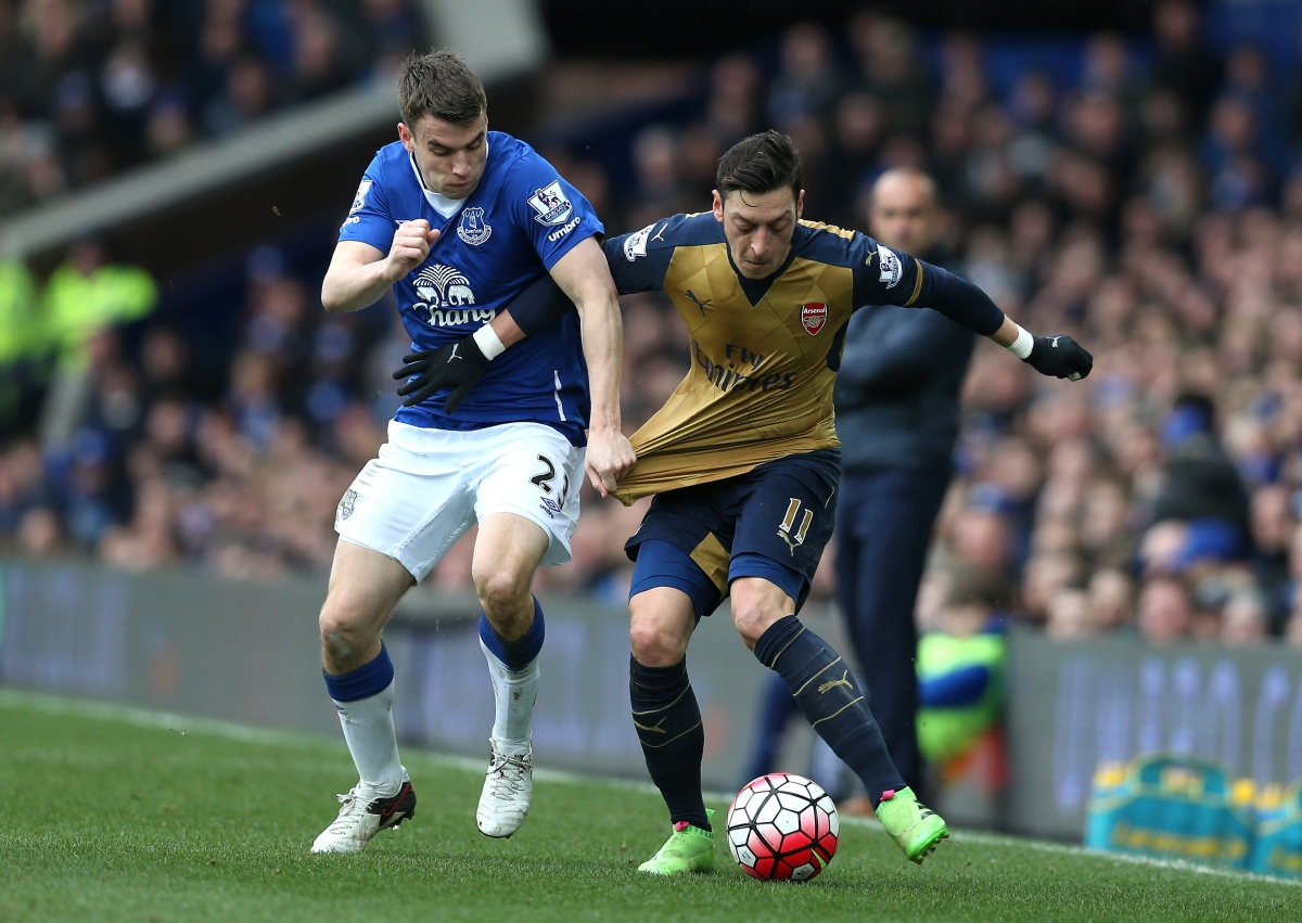 Mesut Ozil (right) on the ball