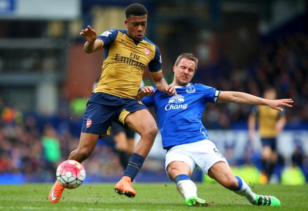 Alex Iwobi battles for the ball