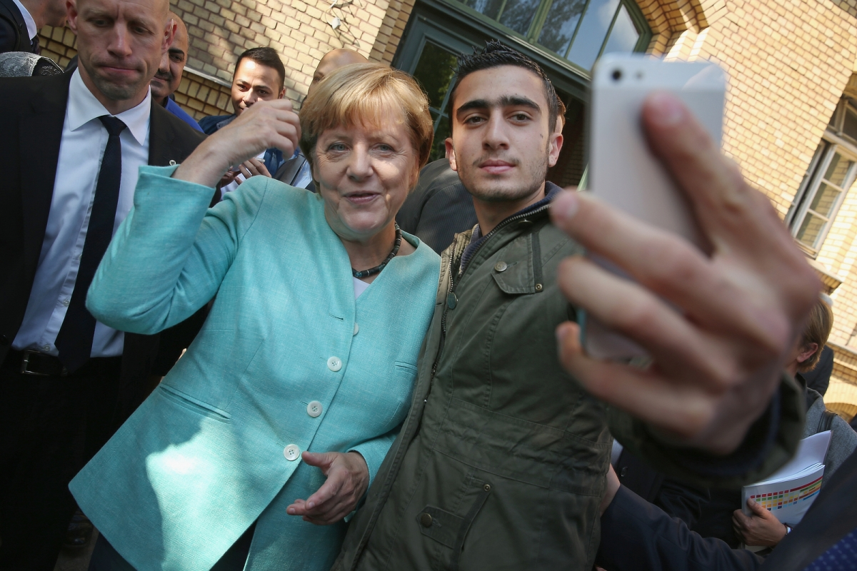 Angela Merkel migrants shelter selfie
