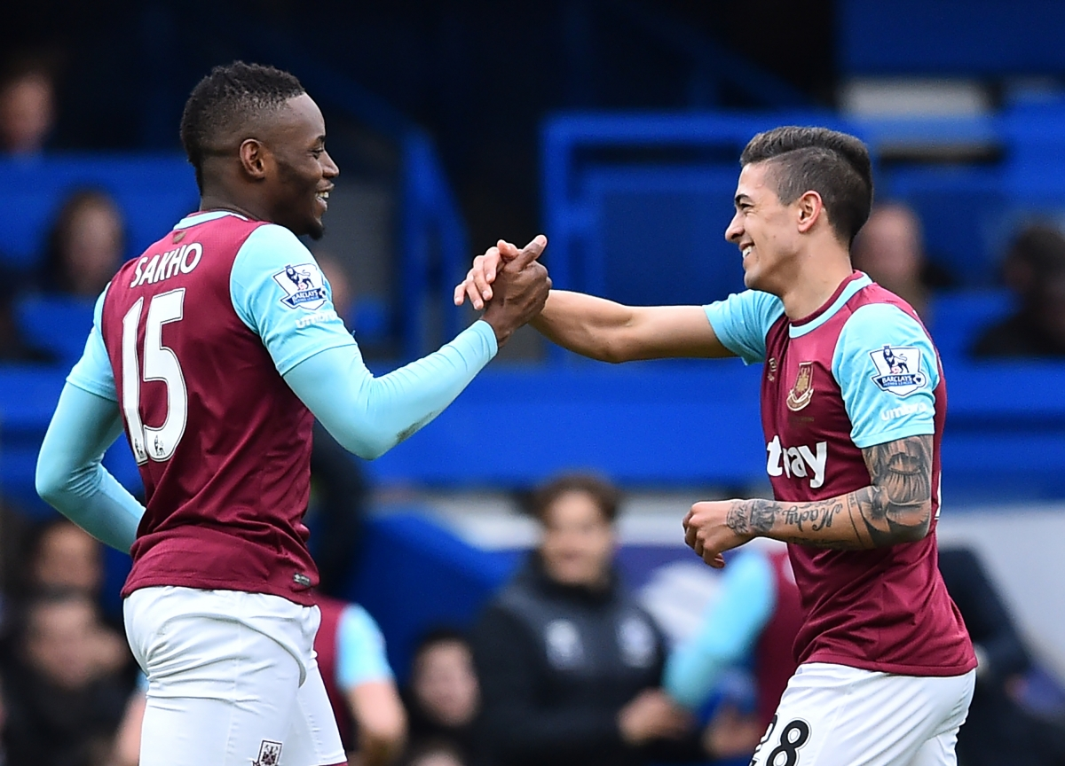 Sakho and Lanzini celebrate