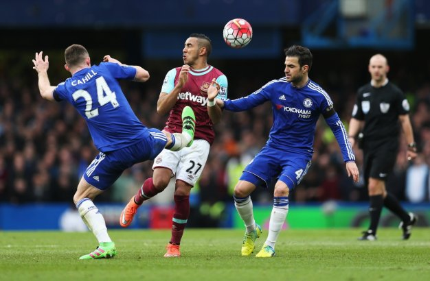 Chelsea players scrap for the ball
