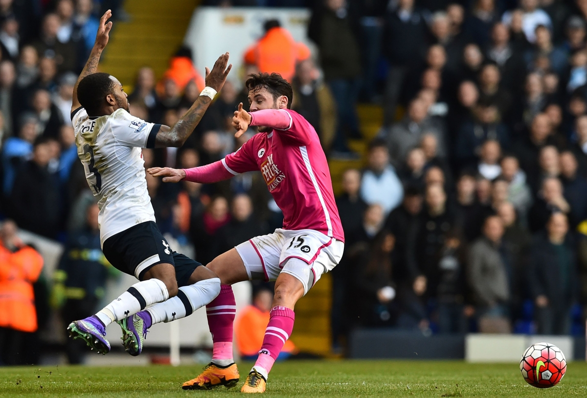Danny Rose goes down under a tackle