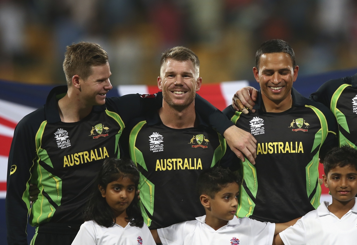 The Aussie players laugh during the anthems