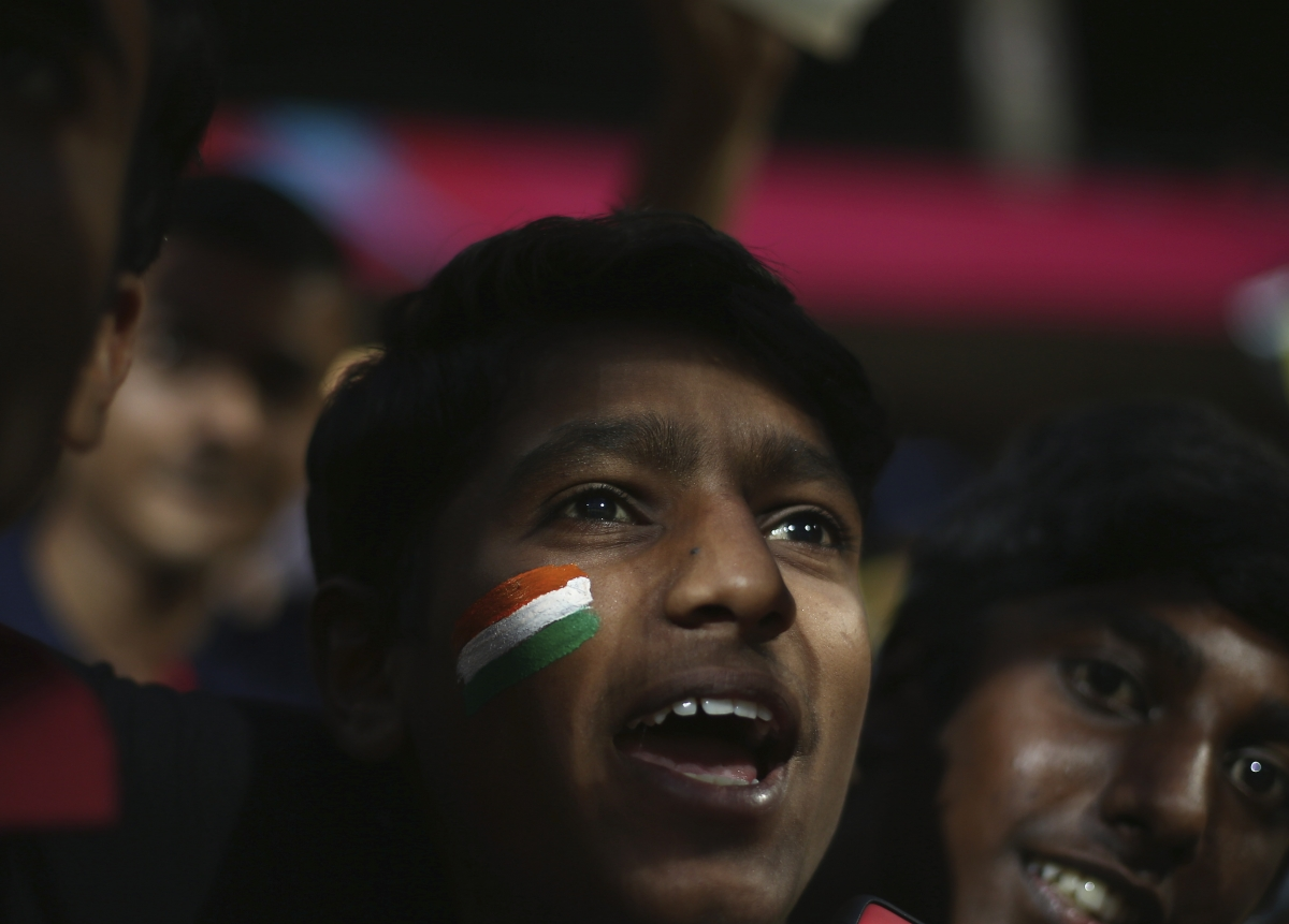 A fan cheers in Bangalore
