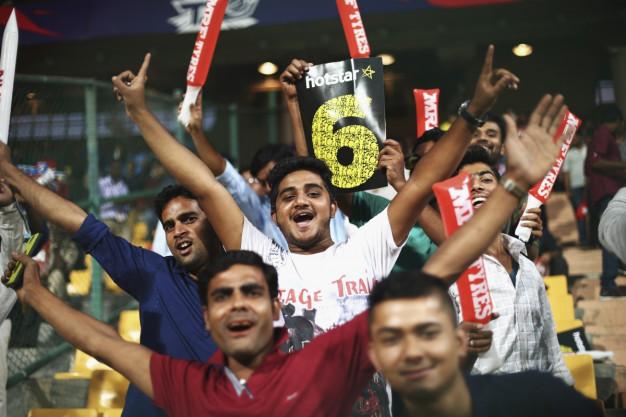 Fans celebrate a six