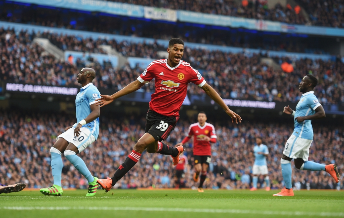 Marcus Rashford celebrates scoring against Manchester City