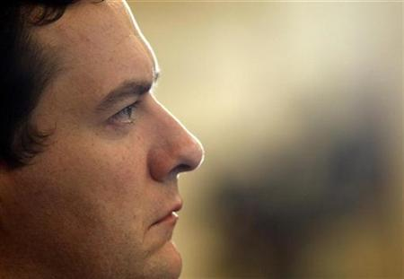 Chancellor George Osborne listens to David Cameron