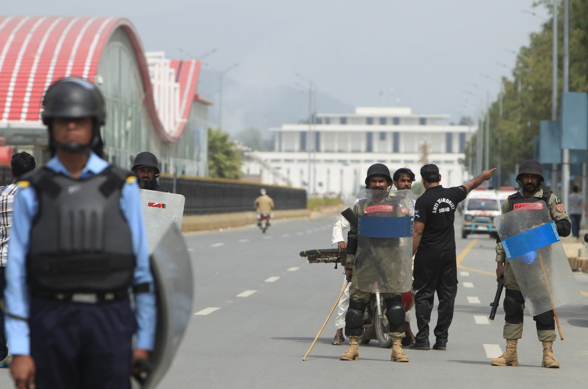 Security officials guard on a road leading towards Parliament building after clashes between protesters.