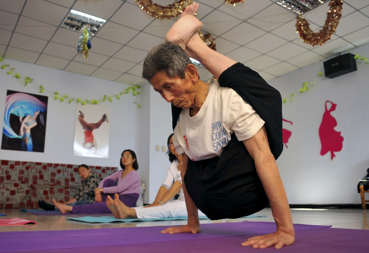 84-year-old retired worker, practices yoga