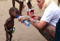 Anja Ringgren Loven cares for Nigerian child