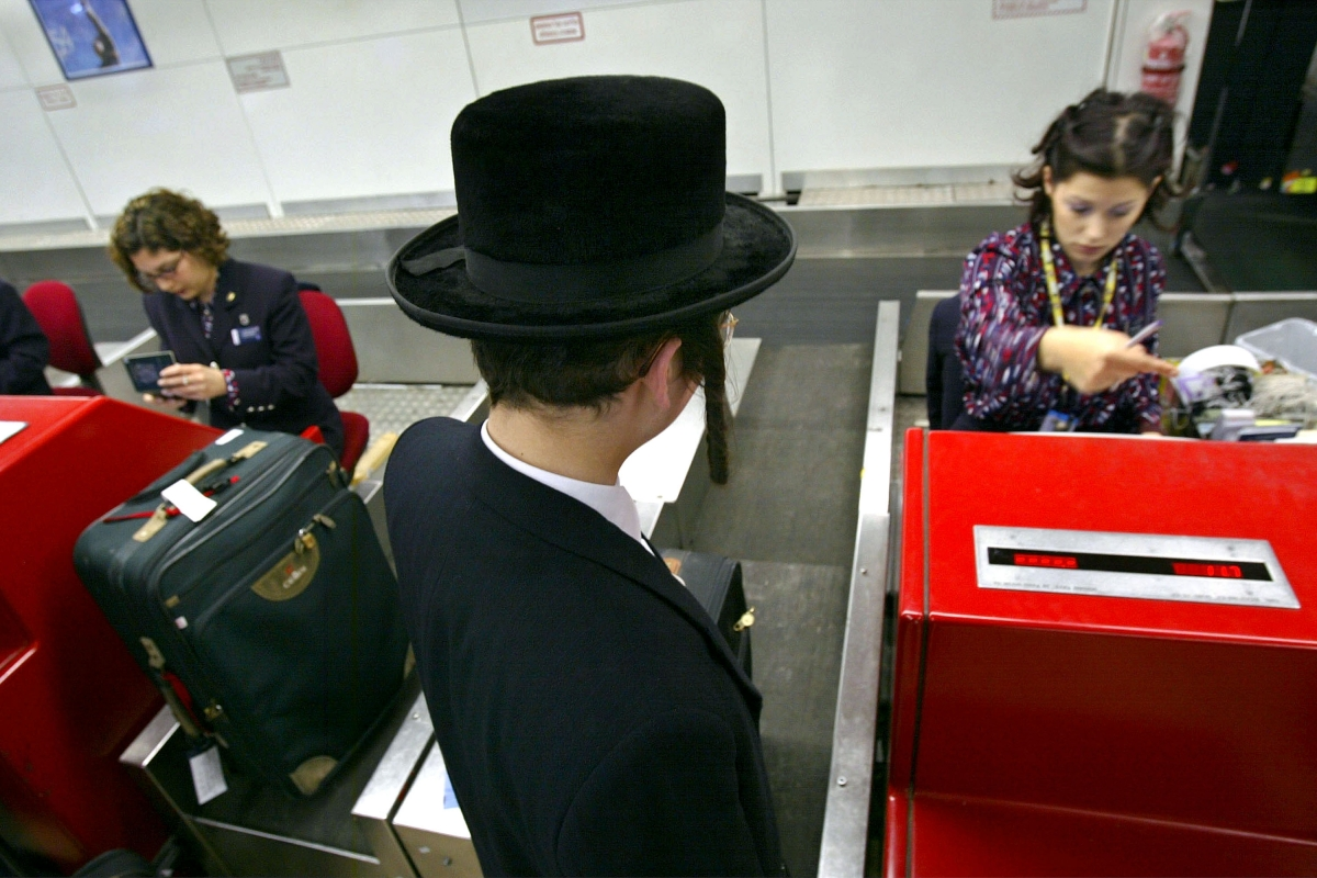 An ultra-Orthodox man boarda a flight in