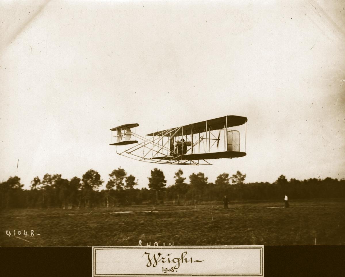 The Wright Flyer II biplane in flight.