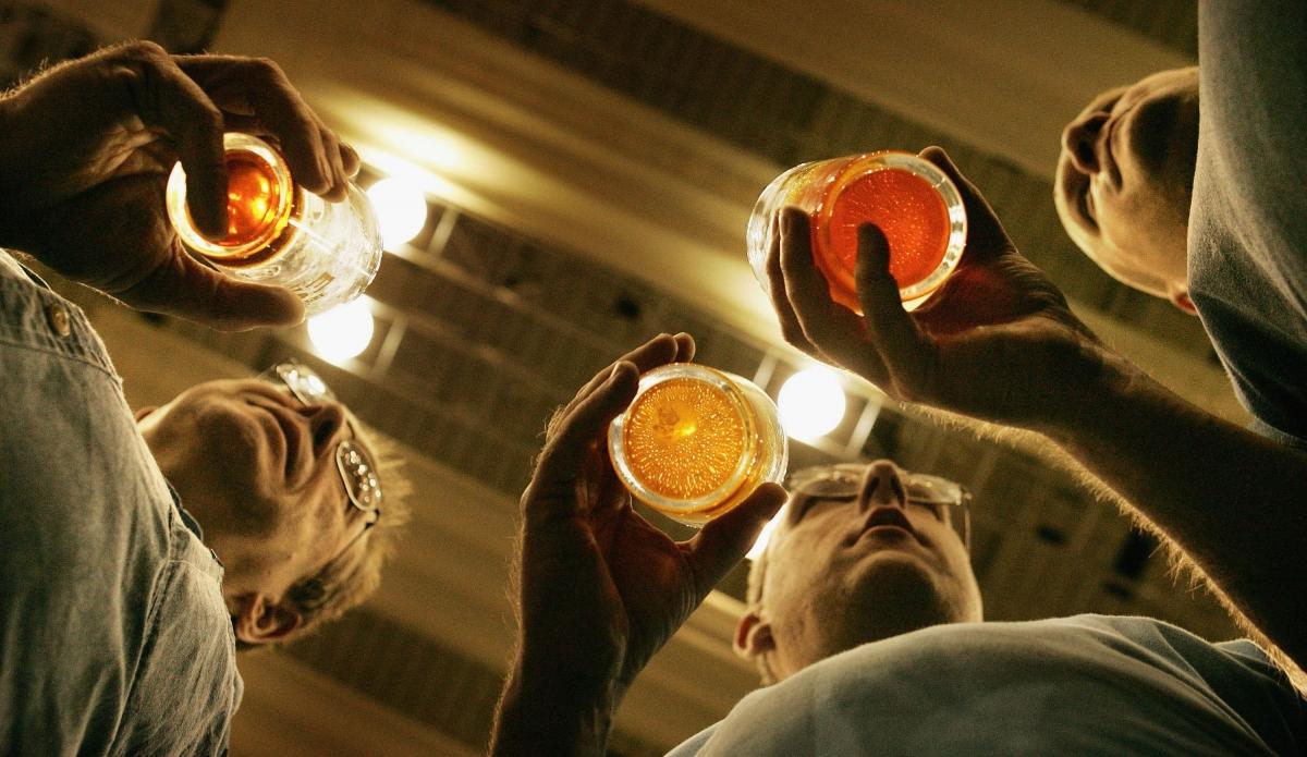 People enjoy pints of beer