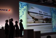 Air France flight attendants looks at a slide show in New York June 25, 2014.