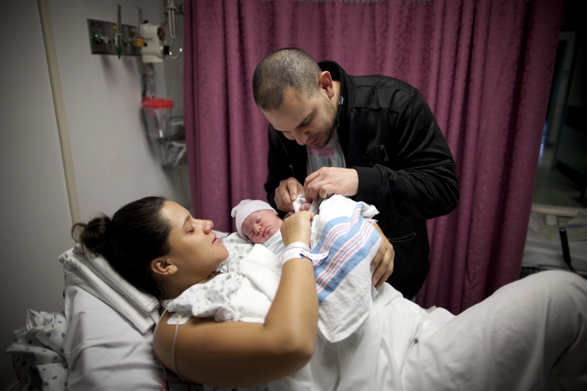 Newborn baby with parents