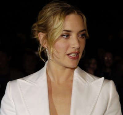 Actress Kate Winslet poses as she arrives at the 20th Annual Santa Barbara International Film Festival