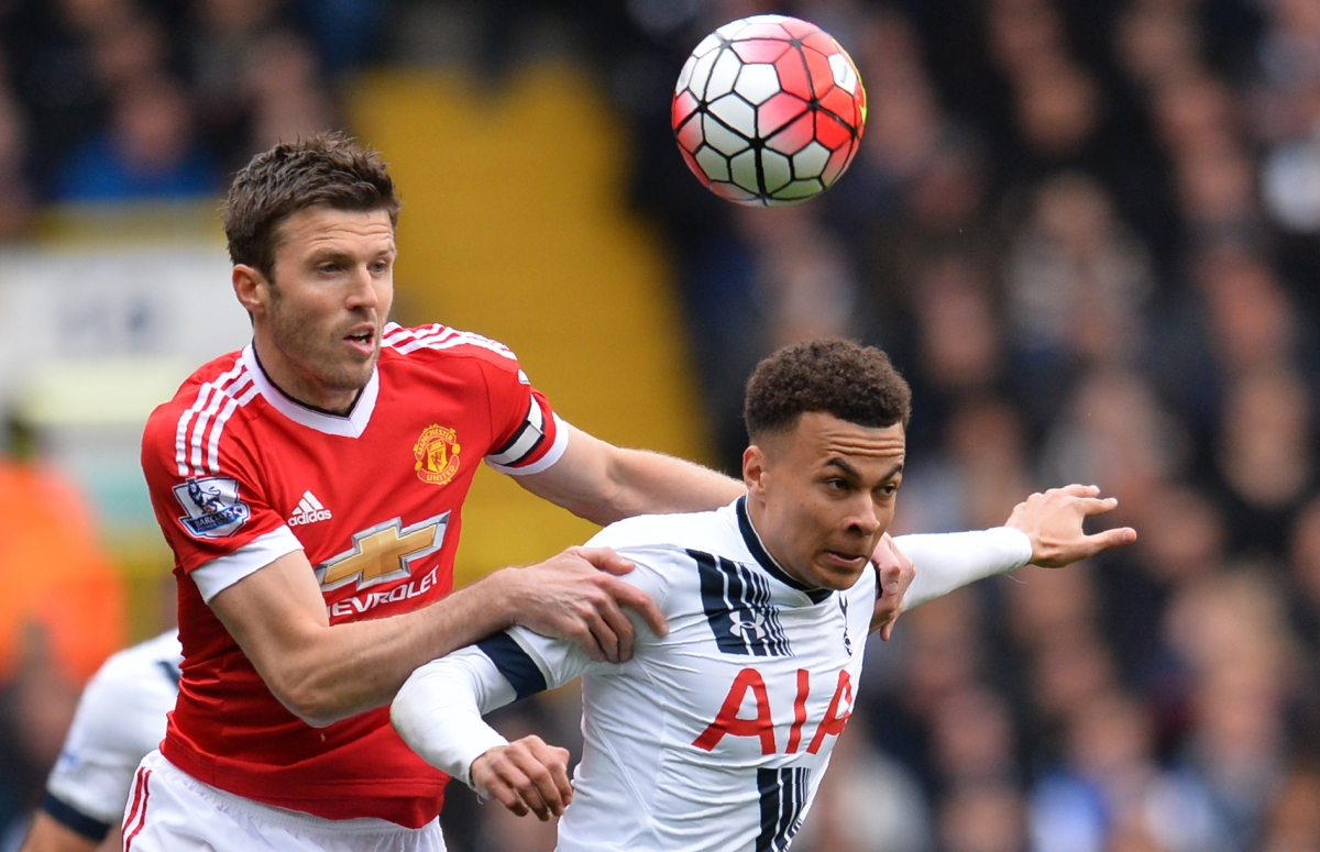 Michael Carrick (left) in action against Spurs