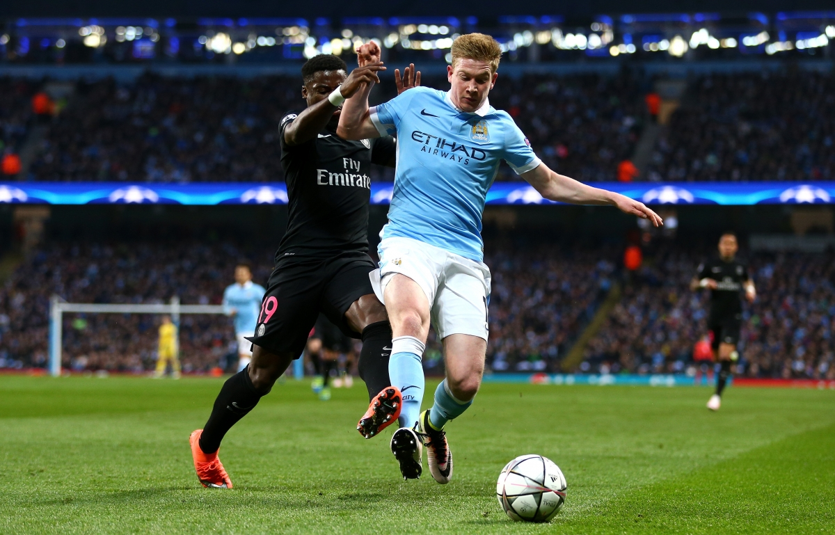 Kevin de Bruyne (right) wins the ball